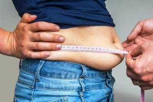 Lemak menumpuk di area perut adalah tanda buruknya metabolisme, dan hal ini sangat bisa disebabkan kurangnya olahraga. (iStockphoto)