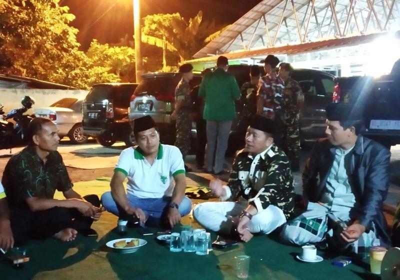 Pengurus Pemuda Katolik Komda Lampung mengunjungi Posko Mudik Kebhinekaan yang diinisiasi oleh GP Ansor dan Banser di ruas Jalinsum, Kecamatan Panjang, Bandar Lampung, Sabtu,  1 Juni 2019.